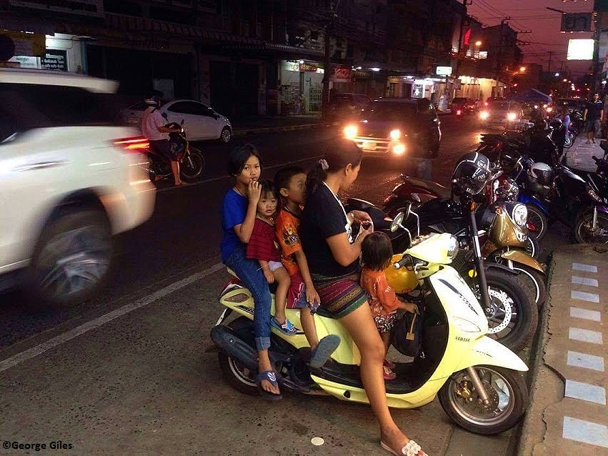 A family out for the evening by way of moped. Photo credit - George Giles
