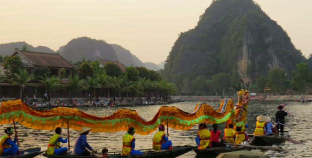 Boat races for the Full Moon Celebration in a small village near Ninh Binh, Vietnam www.knowntoventure.com