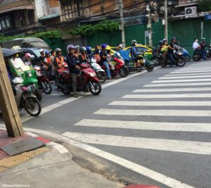 A busy crossstreet in Bangkok's China Town. Pedestrians beware. Top 20 Things Learned living in Thailand www.knowntoventure.com