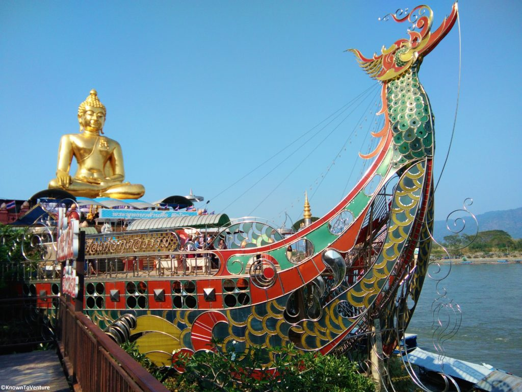 Golden Triangle. A golden Buddha riding a stained glass boat along the border of Thailand, Laos, and Myanmar Chiang Rai www.knowntoventure.com