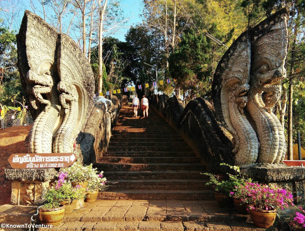 The naga staircase leading up to the 14th century temple shrine. Golden Triangel Chiang Rai province Thailand www.knowntoventure.com