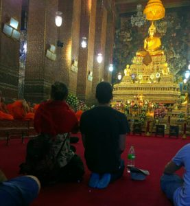 Monks chanting during prayer time in Wat Pho, Bangkok, Thailand www.knowntoventure.com