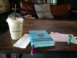 Travel journals and postcards go best with iced coffee. Travel tips for any destination www.knowntoventure.com