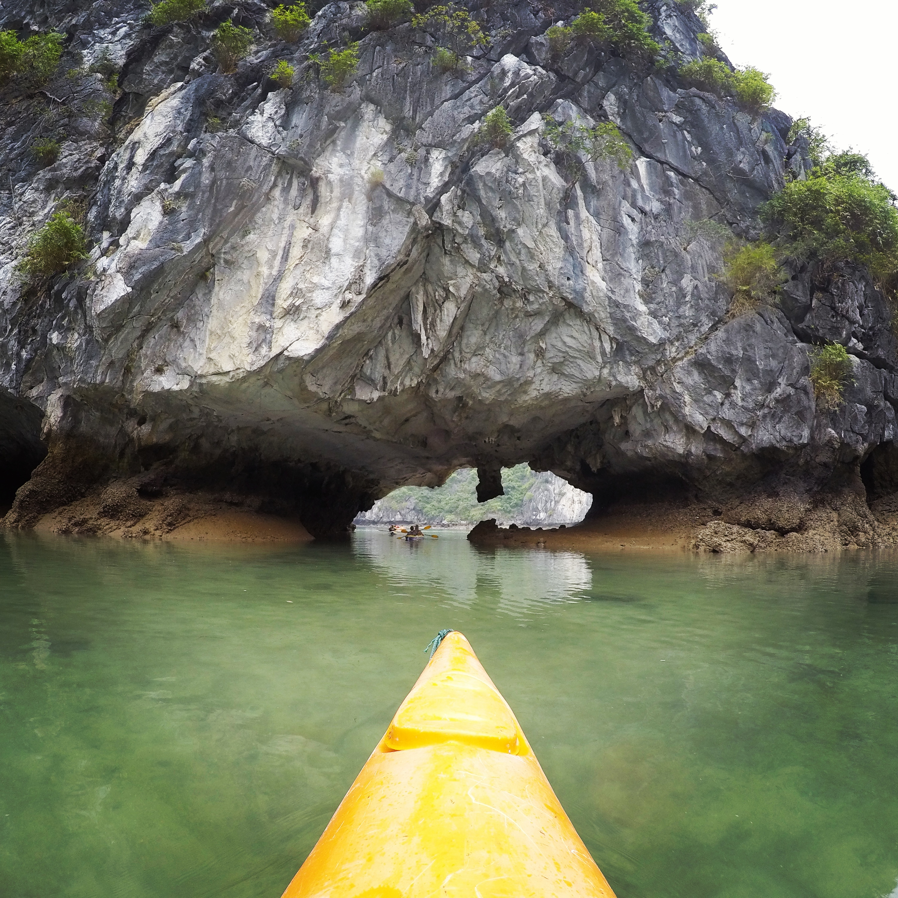 A cave to explore while kayaking Halong Bay Vietnam www.knowntoventure.com