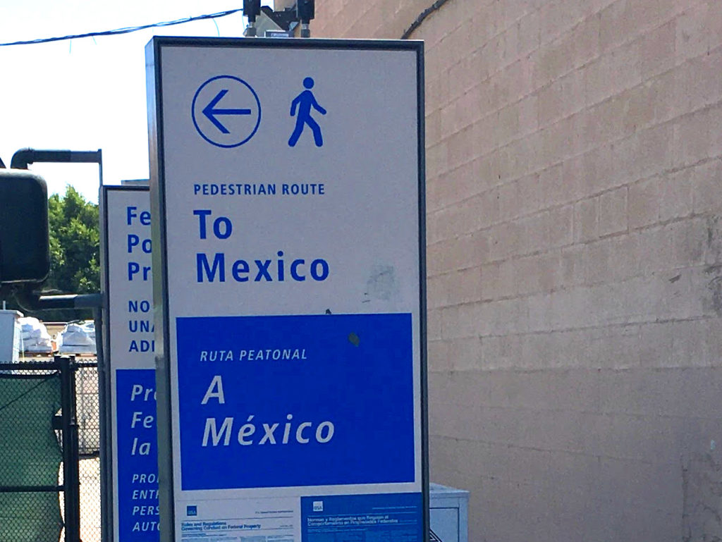 Pedestrian entrance to Mexico www.knowntoventure.com Does the sign suggest moonwalking?